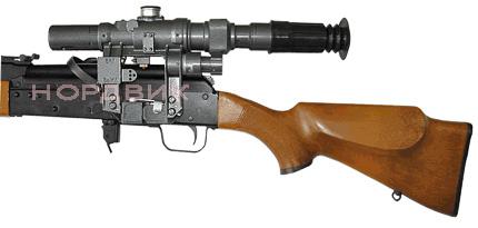 Оптический прицел НПЗ ПО 3-9х24-1 установлен на карабине Сайга.